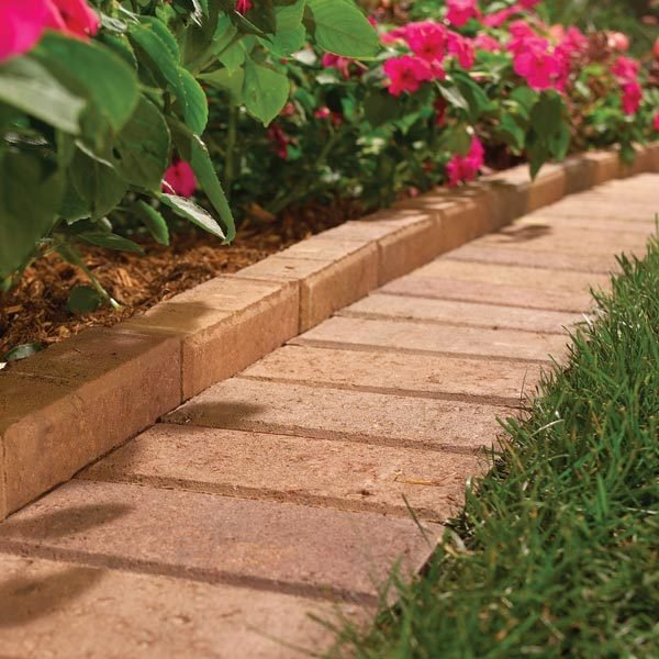 The best garden bed edging tips the family handyman for Brick edging for your flower beds