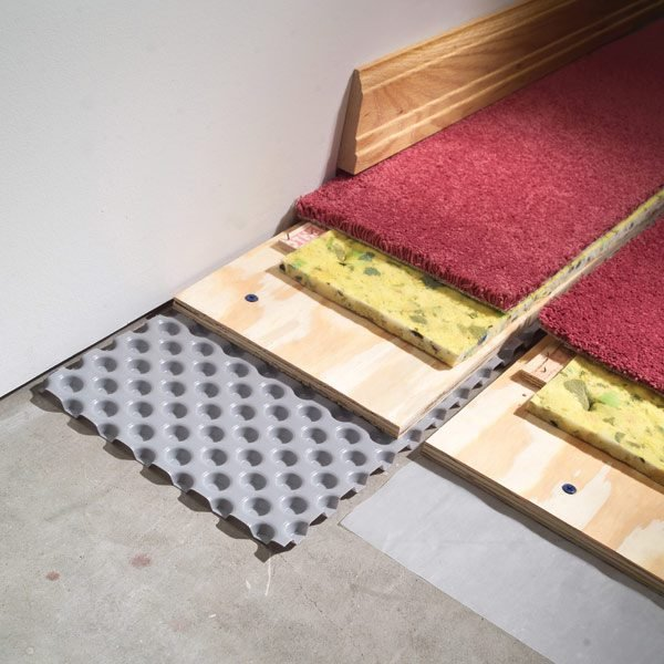 How to carpet a basement floor the family handyman for What can i do to my concrete floor