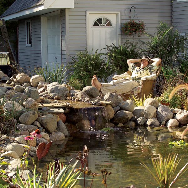 Build a backyard pond and waterfall the family handyman for Garden pond design and construction