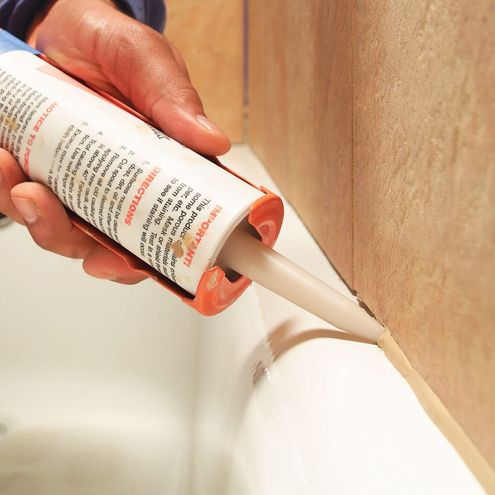 bathtub caulking tips the family handyman On bathroom caulk