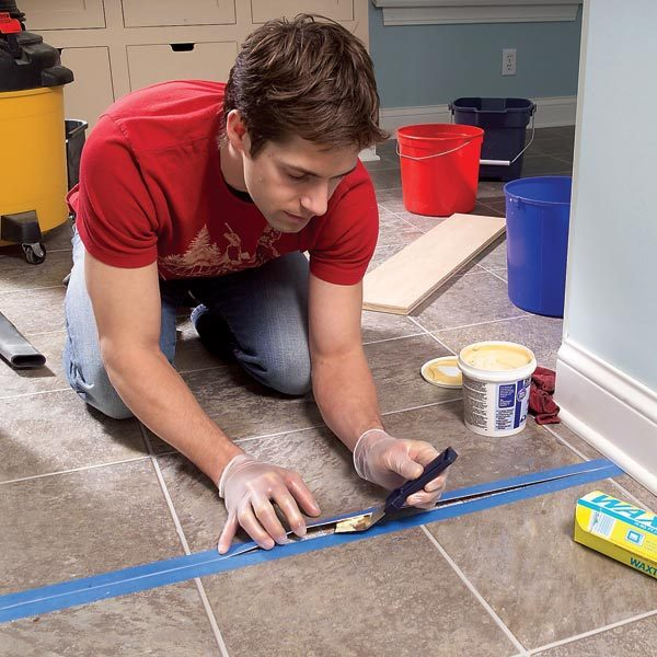 Repair and reglue sheet vinyl floors the family handyman for How to seal vinyl flooring seams