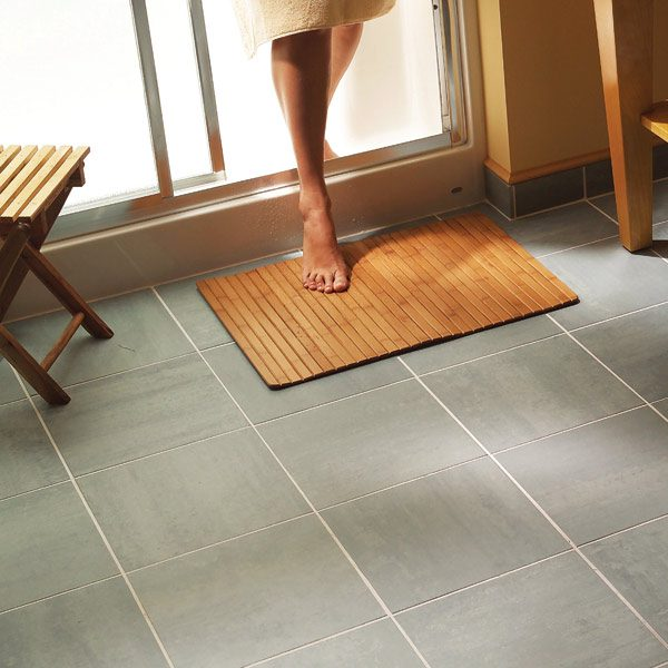 Install a ceramic tile floor in the bathroom the family handyman Ceramic tile flooring installation