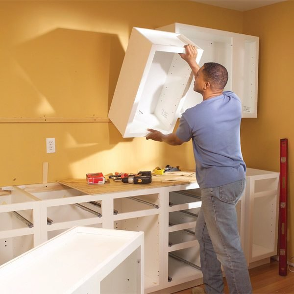 Installing kitchen cabinets the family handyman for Hanging kitchen cabinets