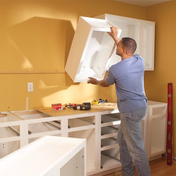how to install cabinets in kitchen install cabinets like a pro the family handyman 17037