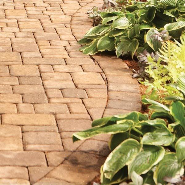 Landscaping tips for your backyard the family handyman for Camino de piedra en el jardin