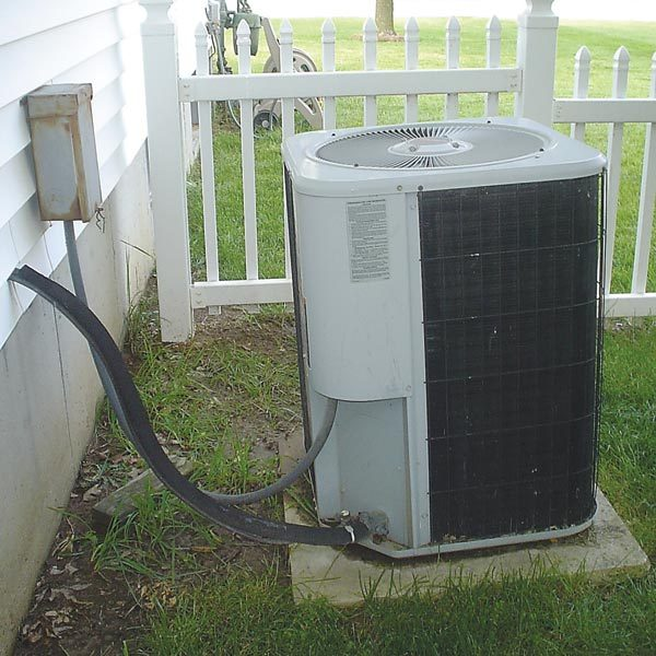 Fix a sinking air conditioner pad the family handyman for Ac condenser pad installation