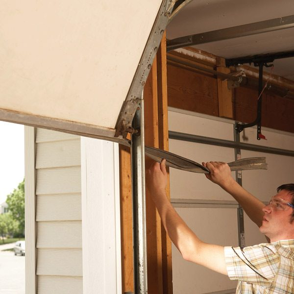 Fixing garage doors the family handyman for 2 door garage door