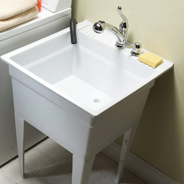 Replace a grungy laundry sink with a new one and upgrade with a soap ...