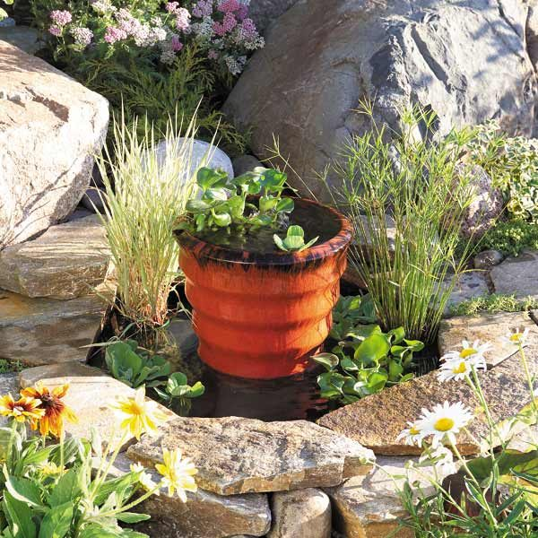 How to build a pond fountain in one day the family for Simple water features for backyard