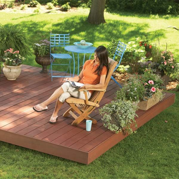 Backyard decks build an island deck the family handyman for Backyard decks