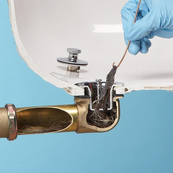Unclog a bathtub drain without chemicals the family handyman for How to unclog a kitchen sink drain with standing water