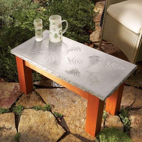 Create a polished concrete table with a solid wood base, with inlays ...
