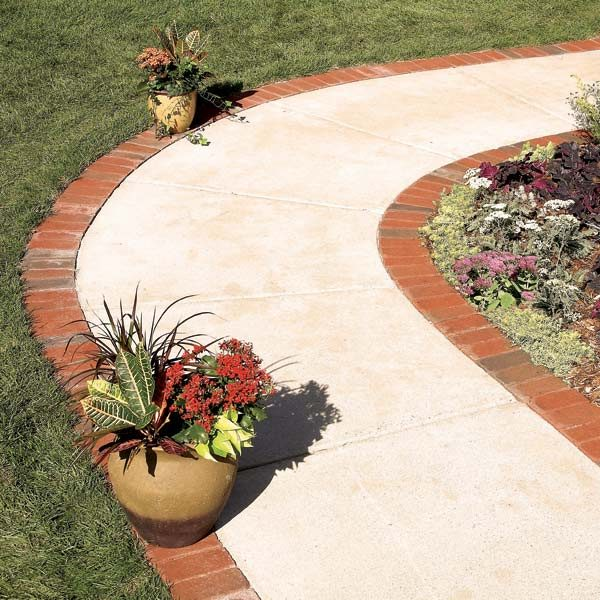 Use brick borders for path edging the family handyman for Brick sidewalk edging