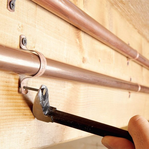 Quiet Pipes With Pipe Straps The Family Handyman