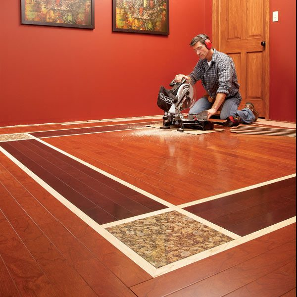 Diy hardwood floors lay a contrasting border the family for Shades of laminate flooring