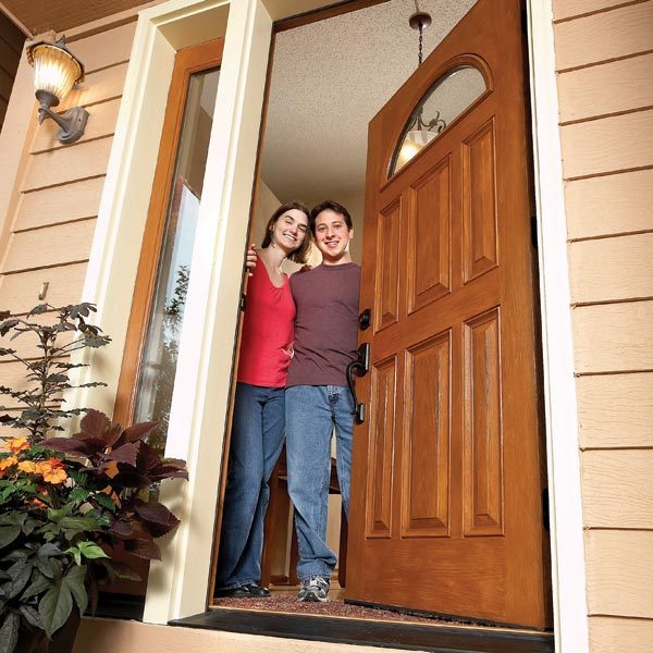 How to install a door the family handyman for Front entry door installation