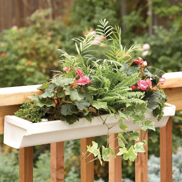 Deck how to build a deck planter the family handyman for Rain gutter planter box