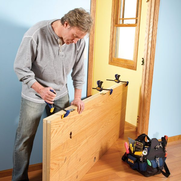 How to hang a new door the family handyman - How to install a prehung exterior door ...