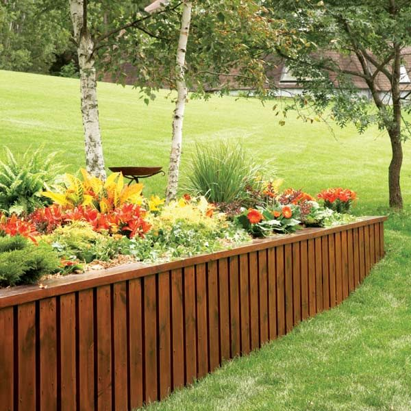 Retaining wall the family handyman for Wooden garden wall ideas