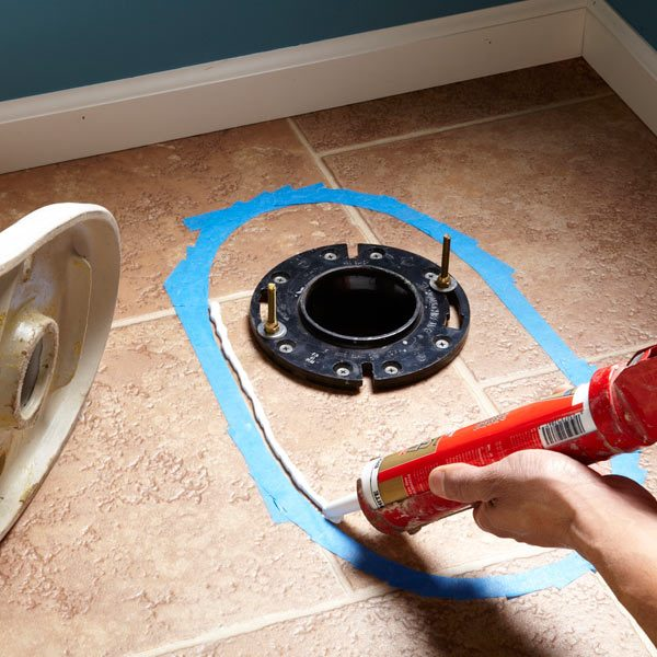 How to caulk a toilet to a floor the family handyman Bathroom toilet installation