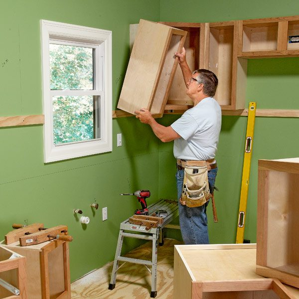 Install cabinets like a pro the family handyman for Cabinet installation