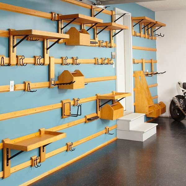 ... on a french cleat system like this one- it looks similar to yours: http://www.familyhandyman.com/garage/storage/customizable-garage-storage /view-all