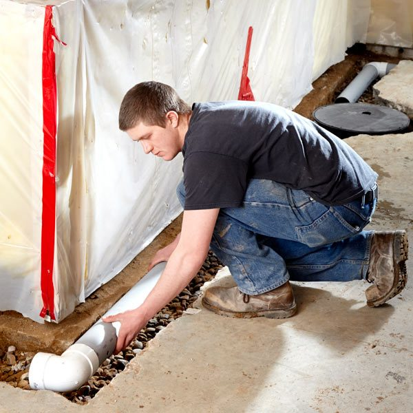How to waterproof a basement the family handyman - Interior basement drainage systems ...