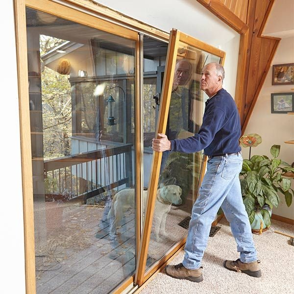 drafty patio door weatherstripping stops drafts cold the family handyman. Black Bedroom Furniture Sets. Home Design Ideas