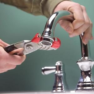 how to fix a clogged ear from water