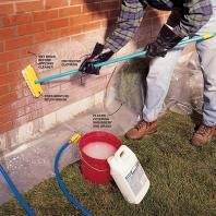 Scrubbing off hard water stains when cleaning a brick wall.
