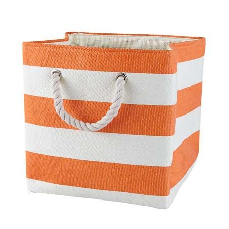 "<b>Use Fabric Bins in High Places</b></br> Store lesser-worn clothing like seasonal clothing, or too-big or too-small items in fabric bins, like this <a href=""http://www.landofnod.com/orange-stripes-around-the-cube-bin/s560316"" title=""Stripes Around the Cube Bin"" target=""_blank"">stripes around the cube bin</a> from The Land of Nod, on a high shelf where adults can easily reach them when the time comes."