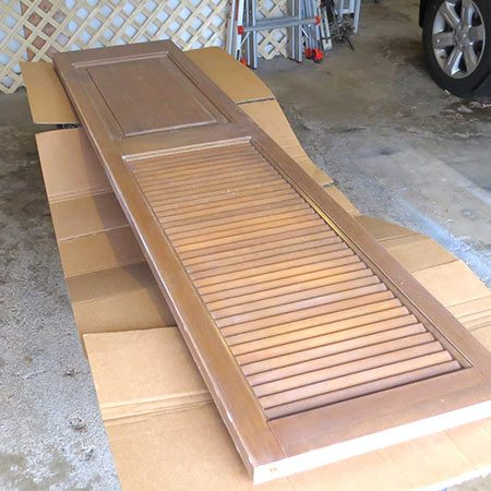 <b>Prep for Painting</b></br> <p>Remove the hardware from the door and give it a good sanding. Remove a few of the shutter slats with the back-end of a hammer and a little wiggling. This will leave space to drape magazines at the bottom organizer.</p>