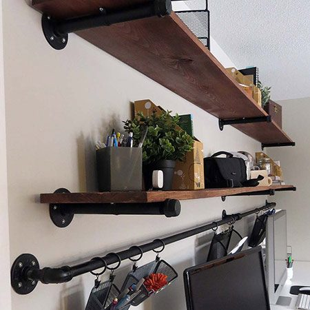 <b>Get Vertical</b></br> <p>They decided to make two shelves the full length of the desk, with a slider bar underneath for flexible desk storage. Before assembly, clean and spray all pipe pieces with two coats of matte black spray paint. This step is optional, depending on the look you want to achieve.</p>