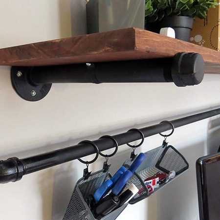 "<b>Use Common Parts for Easy Shelving</b></br> <p>Shelf brackets for these shelves are made by attaching a flange, a 9"" pipe, and an end cap together and mounting with drywall anchors to the wall. The 9"" deep shelf is a piece of lumber is stained and sanded. The shelf is attached with a U-shaped bracket around each pipe screwed to the underside of the wood shelf.</p>"