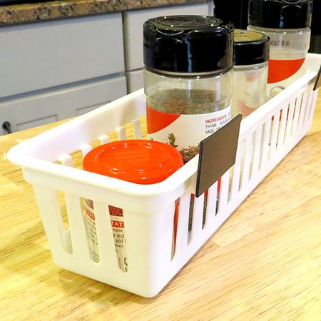 <b>Harness the Power of Magnets</b></br> <p>Glue heavy-duty magnets to the side of a plastic or wire pencil bin, and stick to the side of your refrigerator for quick access. Try stacking a few bins in a row, and organize each by type – baking, grilling, Italian, etc </p>
