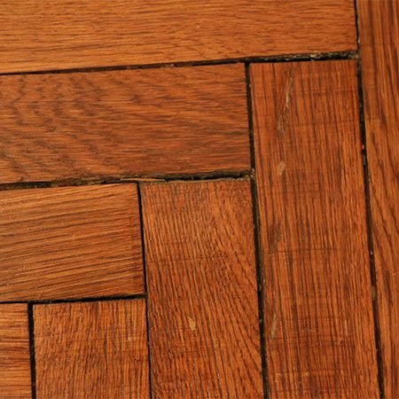 <b>Minor Floor Repairs Make Hardwood Easier to Clean</b></br> <p>If you're a proud owner of original hardwood flooring in a century-old home, then your boards have likely swelled, shrugged or shrank over time, leaving gaps and crevices. Dust, dirt and even food can easily find their way into these neat little gaps, looking ugly and doing further damage to your hardwood. The solution? Plug those holes. Pick up a standard wood filler and a putty knife at your local hardware store, and go to town filling and smoothing any noticeable areas. Wait for it to dry, and then work on carefully staining the filled sections to match the original wood. It doesn't have to be perfect, and the results will astonish you.</p>