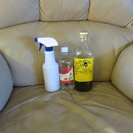 <b>Make Your Own Solution</b></br> <p>To clean the entire surface, mix 2 parts white vinegar with 1 part olive oil in a spray bottle and shake well. (You can also add a few drops of fragrant essential oils to cut the vinegar smell).</p>