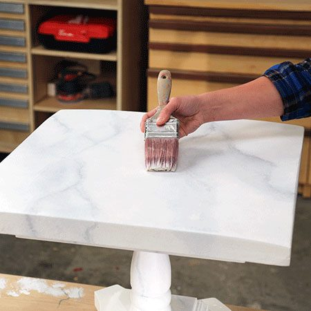 <b>Apply Coats of Poly</b></br> <p>Finally, apply two coats of clear, water-based polyurethane with a satin finish. Allow a full 24 hours for the table to completely dry before using it.</p>