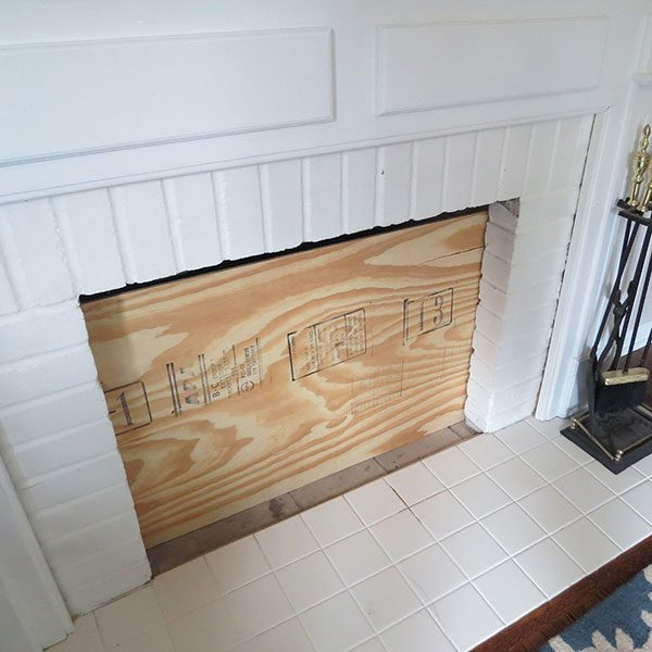 """<b>Cut Plywood to Size</b></br> <p> First, measure your fireplace opening and determine the size of plywood insert needed. If your fireplace already has a glass door front, you will want to measure the insert to fit exactly over this space. If your fireplace is open with brick or stone creating a lip, you may want to measure the insert to sit just behind this lip. Cut plywood to size, checking that the insert easily fits before moving on to the next step. See <a href=""""https://www.familyhandyman.com/tools/circular-saws/how-to-cut-plywood"""" target=""""_blank"""">here</a> for tips on cutting plywood.</p>"""