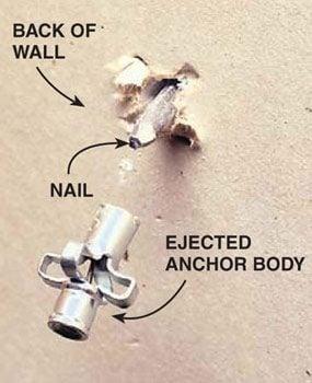 Photo 2: Push the anchor through the wall