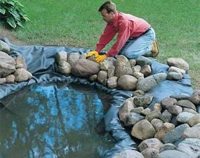 How to build a water garden with waterfall the family for Building a koi pond step by step