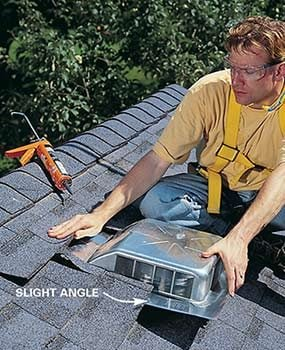 Photo 12: Push the vent under the shingles
