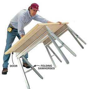 Build a worktable out of folding sawhorses.