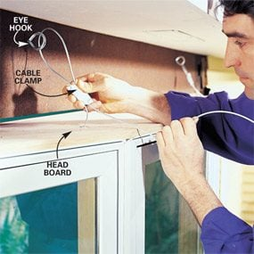 Photo 9: Hold the window in place with support cables.