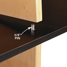 Tap the pins through the shelves and into the standards.