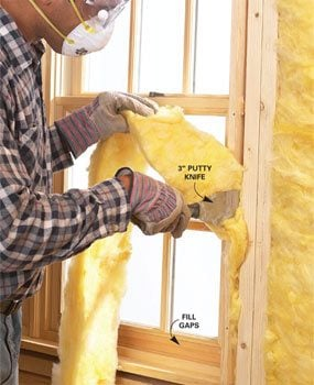 Use a putty knife to stuff gaps with fiberglass