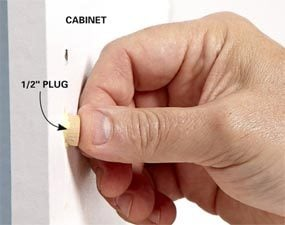 Repair a cabinet hinge screw hole with a plug