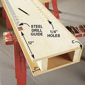 Start the drilling guide a foot up from the bottom of the built-in bookcase.