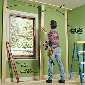 Attach the wall cleats for the built-in bookcase to the wall.