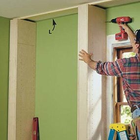 Build the column partitions for the built-in bookcase and tip them into place.